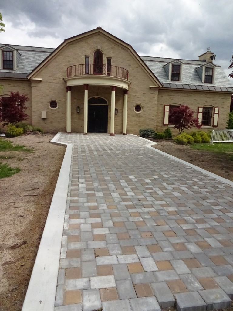 Classy brick sidewalks will lead to the entrances to the Art and Home Center.